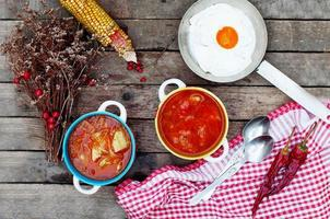 Traditional Ukrainian Russian vegetable borscht on the old wooden background. photo