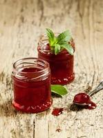 Delicious homemade strawberry jam in a jar, selective focus photo