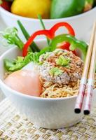 Chinese noodles with minced pork and egg in bowl photo