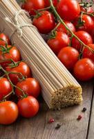 Whole wheat spaghetti and tomatoes photo