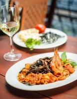 Traditional Italian dish - black tagliatelle with seafood