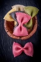 Italian Farfalle pasta in bowls photo