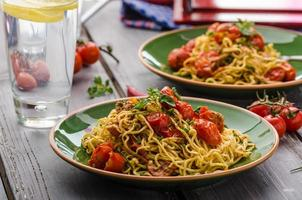 Homemade semolina spaghetti with cherry photo