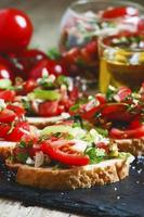 Italian bruschetta with tomato, onion and bell pepper