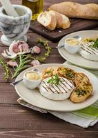 Grilled camembert with mini herbs baguettes photo