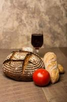 Loaf of fresh rye bread on a table photo