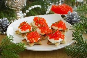 Canape with red caviar for party, selective focus photo