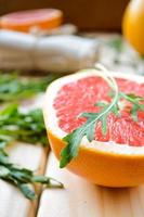 Grapefruit with fresh arugula leaves