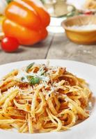 Pasta bolognese on the wooden table photo