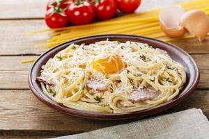 pasta carbonara  with egg yolk and parmesan cheese