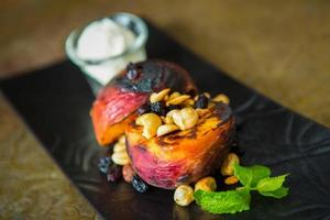 Grilled peaches with nuts and ice-cream