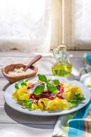 Tasty pappardelle pasta with tomato sauce and basil photo