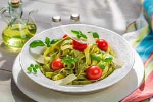 Delicious tagliatelle with parmesan photo