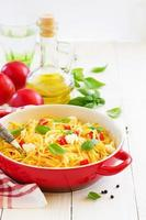 Gluten-free pasta with tomato sauce and cheese. photo