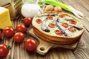 Kish with sprats and cherry tomatoes photo