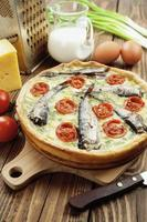 Quiche with sprats and cherry tomatoes photo