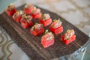 Concentrated watermelon infused with truffle oil topped with tuna