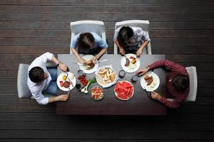 two couples eating dinner