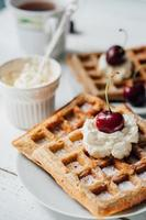 Breakfast with wholegrain waffles and whipped cream