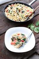 Pasta with spinach and tomato photo