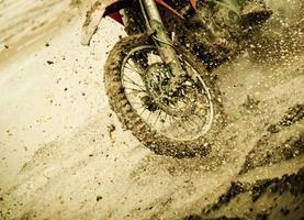 Motocross detail of splashing mud photo