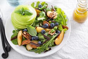Fresh healthy salad with greens and apple photo