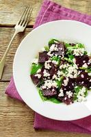 salad with beets, spinach and goat cheese photo