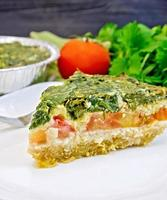 Pie celtic with spinach on board photo