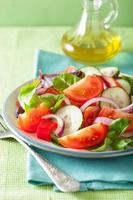 healthy tomato salad with onion cucumber pepper photo
