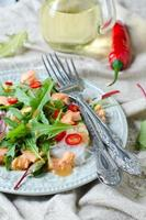 Salad with rice noodles and salmon