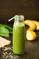 fresh detox green smoothie with spinach and outmeal photo