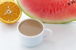 Coffee with milk, watermelon and orange photo