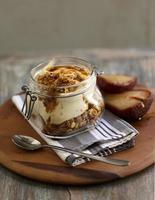 Muesli in jar with yoghurt and pears