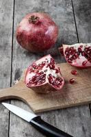 broken pomegranate on wooden surface