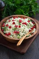 Cauliflower couscous with herbs and pomegranate, vertical