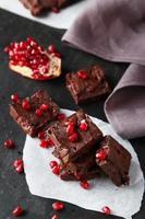 Homemade chocolate fudge with pomegranate