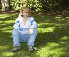Beautiful Redhead Woman talking on Cell Phone photo