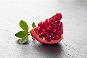 Piece of pomegranate, close up photo