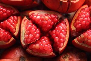 Pomegranate slices and seeds photo