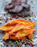 Carrot and beet chips with spices photo