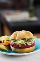 Beetroot burger on white bread photo