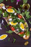Greek Steak Salad on Bread with Eggs and Feta photo