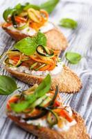 Zucchini,carrot and cheese bruschetta photo