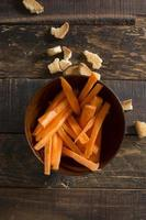 Fresh cut carrot on wooden background