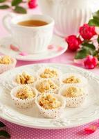 Homemade cookies with peanuts and corn flakes in white chocolate. photo