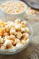 bowl of popcorn on a wooden table, caramel popcorn