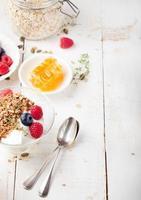 Healthy breakfast. Granola with pumpkin seeds, honey, yogurt, fresh berries photo
