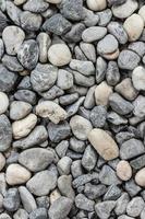 fondo liso de piedra de río foto
