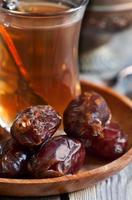 Arabic tea and dates photo