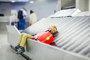 little tired kid boy at the airport, traveling